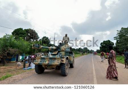 KARTIAK,SENEGAL-SEPT 18:military tank patrols the ritual of Boukoutt of Initiation ceremony on Sept 18, 2012 in Kartiak,Senegal.The ceremony occurs every 30 years and celebrates boys becoming men. - stock photo