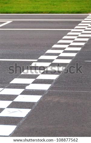 Karting Circuit Chessboard Start / Finish Line - stock photo