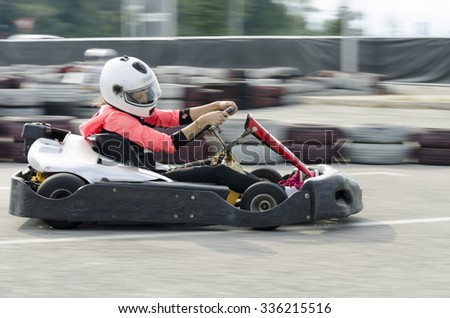 Karting driver motion blued - stock photo