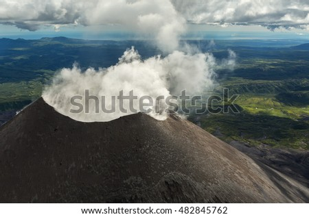 Karymsky is an active stratovolcano. Kronotsky Nature Reserve on Kamchatka Peninsula. View from helicopter.