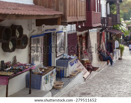 KAS, TURKEY - OCTOBER 15, 2009: Jewelry and carpet store in traditional town houses in the village Kas in Turkey. Kas is a small fishing, diving, yachting and tourist town in Antalya Province. - stock photo
