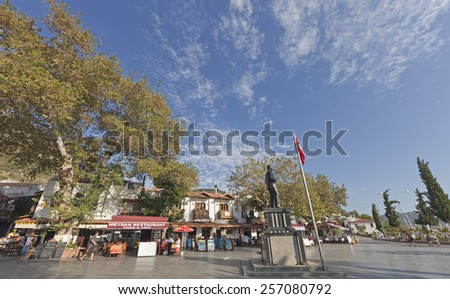 KAS, TURKEY - OCTOBER 15, 2009: Town Square named Cumhuriyet Meydani with traditional town houses and restaurants in the village Kas in Turkey. Kas is a small fishing, yachting and tourist town. - stock photo
