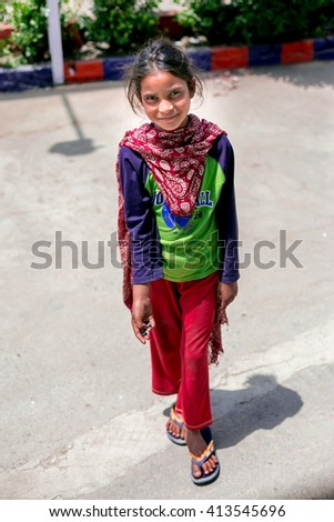 KASHMIR, INDIA - JUNE 29, 2014: Unidentified poor Indian beggar girl on street in Kashmir. Children of the early ages are often brought to the begging profession. - stock photo