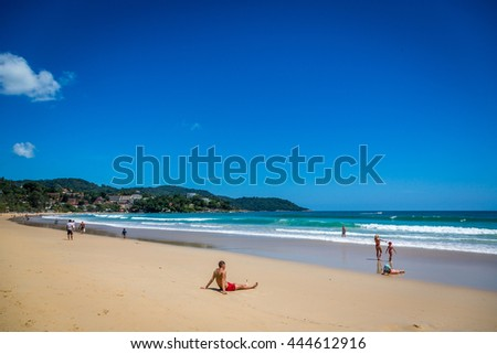 Kata Beach, Thailand - June 4th 2016 - Tourists enjoying a amazing blue sky day in Kata beach, southern Phuket in Thailand, Asia.