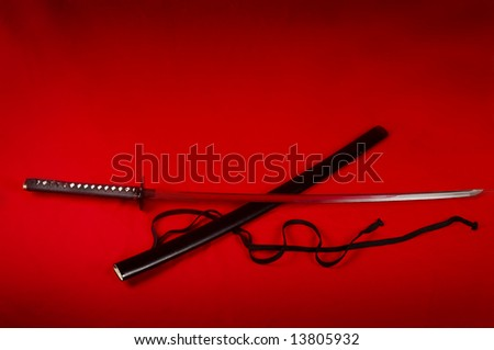 katana on red - stock photo