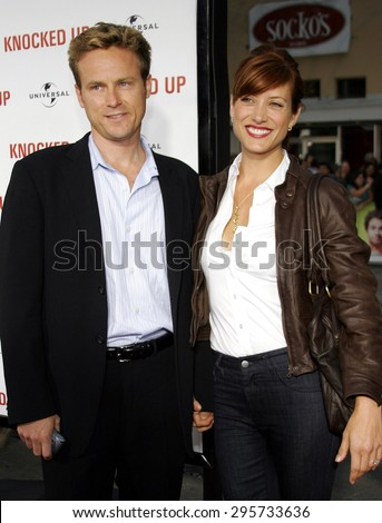 """Kate Walsh and fiance Alex Young attend Los Angeles Premiere of """"Knocked Up"""" held at the Mann Village Theatre in Westwood, California, on May 21, 2007.   - stock photo"""
