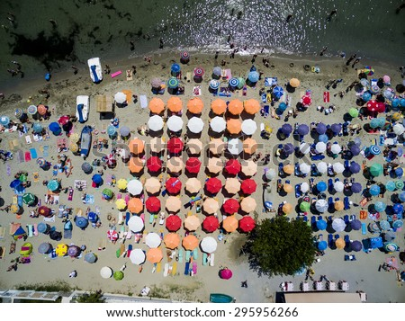 KATERINI, GREECE, JULY 5 2015: Aerial view of the beach of Katerini in Greece. colorful umbrellas and people who swims. Aerial shot - stock photo