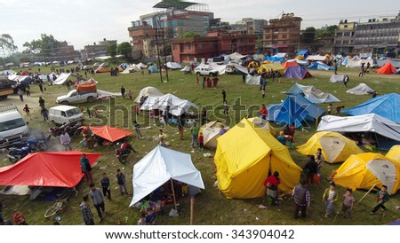 KATHMANDU, NEPAL - APRIL 27, 2015: After a magnitude 7.8 earthquake hit Nepal on April 25, people live in this makeshift camp at Taragaon park, Chuchepati. Aerial view shot with a drone.  - stock photo