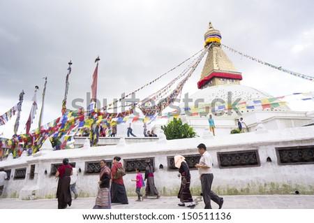 KATHMANDU, NEPAL - APRIL 16: An Unidentified Pilgrimage and tourists around Boudnath,Tibetan Buddhists follow around biggest Stupa in the Kathmandu, Nepal on April 16, 2012 in Kathmandu, Nepal  - stock photo