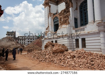 KATHMANDU, NEPAL - APRIL 27, 2015: Damaged palace at Durbar square after 7.8 earthquake in Kathmandu, Nepal - stock photo