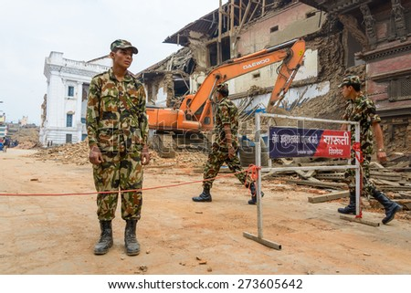 KATHMANDU, NEPAL - APRIL 26, 2015: Military forces starts the rescue effort at Durbar Square which is severly damaged after the major earthquake on 25 April 2015. - stock photo