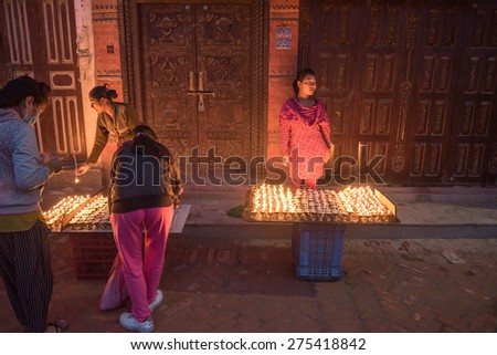 KATHMANDU, NEPAL - APRIL 29, 2015: Nepali residents take part in a candle lighting ceremony for those lost in the earthquake on a street in Kathmandu, Nepal - stock photo
