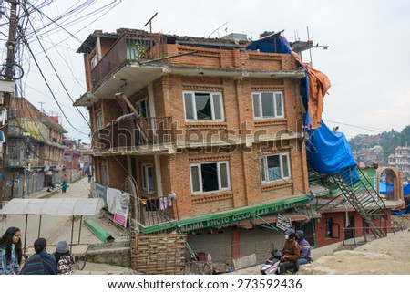 KATHMANDU, NEPAL - APRIL 26, 2015: Partially collapsed house after the 7.8 earthquake hit Nepal on 25 April 2015. - stock photo