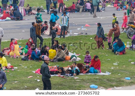 KATHMANDU, NEPAL - APRIL 26, 2015: People stay on an open ground at Tundikhel after their first night outside after the 7.8 earthquake on 25 April 2015. - stock photo