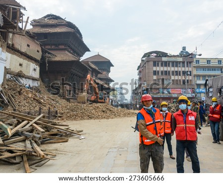 KATHMANDU, NEPAL - APRIL 26, 2015: Rescue team at Durbar Square which was severly damaged after the major earthquake on 25 April 2015. - stock photo
