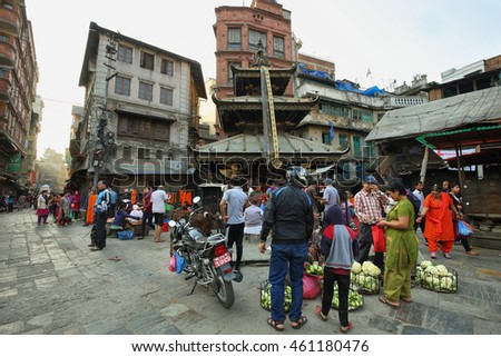 KATHMANDU, NEPAL - APRIL 20, 2016: women vendors selling vegetables in front os a hindu temple in the heart of the old town in Kathmandu, Nepal
