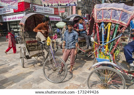 KATHMANDU, NEPAL - CIRCA OCTOBER 2013: rickshaw is a very popular means of public transport in cities in Nepal circa October 2013 in Kathmandu. - stock photo