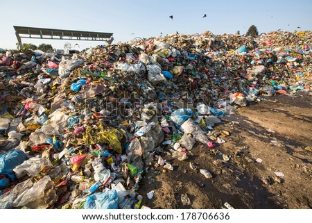 KATHMANDU, NEPAL - DEC 24: Domestic garbage in landfill, Dec 24, 2013 in KTM, Nepal. Only 35% of population Nepal have access to adequate sanitation - stock photo
