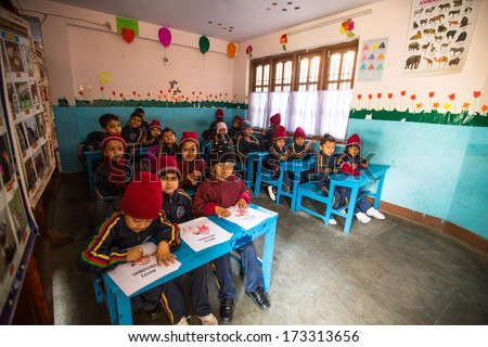 KATHMANDU, NEPAL - DEC 24: Unknown pupils in English class at primary school, Dec 24, 2013 in Kathmandu, Nepal. Only 50% of  children in Nepal can reach 5 grade.