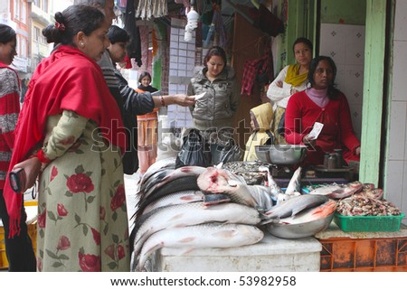 KATHMANDU, NEPAL - JANUARY 3: Street trade in fish, January 3, 2009 in Kathmandu, Nepal. - stock photo