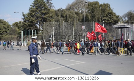 KATHMANDU, NEPAL- JANUARY 20: Supporters of the Communist Party of Nepal (Maoist) protest in Katmandu, on 20 Jan 2010. The protests have been largely peaceful and the polices are armed to stand by