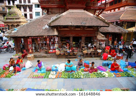 KATHMANDU, NEPAL - JUNE 2013: Everyday scene at Durbar Square - stock photo