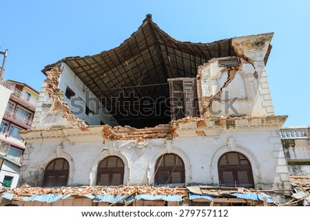 KATHMANDU, NEPAL - MAY 14, 2015: A damaged building after two major earthquakes hit Nepal in the past weeks. - stock photo