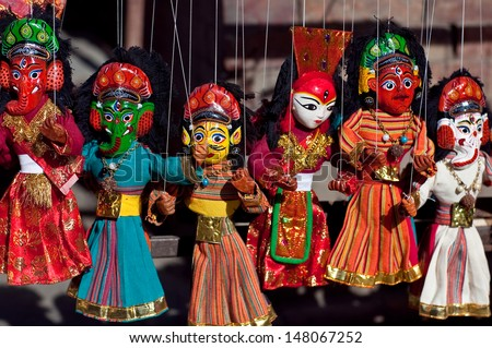 KATHMANDU, NEPAL - MAY 13:  Famous Nepalese puppet show performing at center of Durbar Squar during Kathmandu street Festival on May 13, 2013 in Kathmandu, Nepal - stock photo