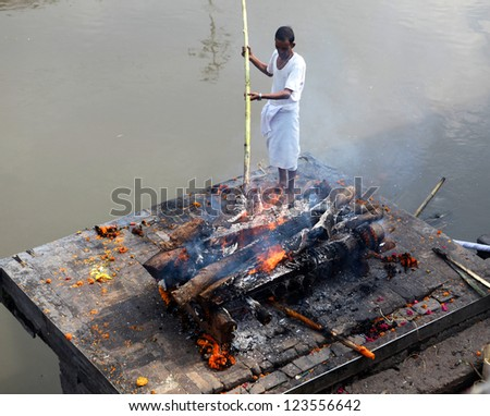 KATHMANDU, NEPAL - NOVEMBER 7: Nepalese people burning corpses on November 7, 2011 in Pashupatinath Temple in Kathmandu, Nepal. Pashupatinath Temple is regarded by Hindus as holy place.