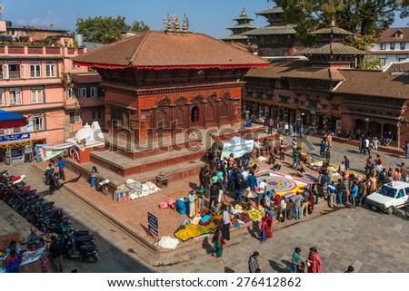 Kathmandu, Nepal - November 3, 2013: The Durbar Square on November 3, 2013 in Kathmandu, Nepal. Kathmandu Durbar Square was almost completely destroyed  in the massive earthquake of 25 April, 2015. - stock photo