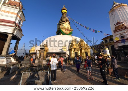 KATHMANDU, NEPAL - SEPT 29 : Nepali people walked around Swayambhunath stupa for worship. Swayambhunath is an Unesco heritage religious complex. On September 29, 2013 in Kathmandu, Nepal  - stock photo