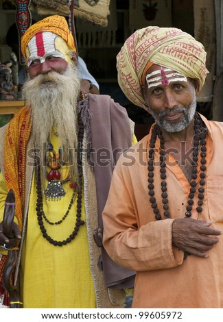 KATHMANDU-OCT 7: Two Sadhu Holy men at Pashupatinath Temple in Kathmandu, Nepal on October 7, 2008. The two primary sectarian divisions in sadhu community are Shaiva sadhus and Vaishnava sadhus. - stock photo
