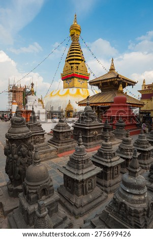 KATHMANDU - OCT 15: view of famous Swayambhunath temple area on October 15, 2014 in Kathmandu, Nepal. The stupa, built in the 5th century AD, is one of the most important Buddhist temples in Nepal. - stock photo
