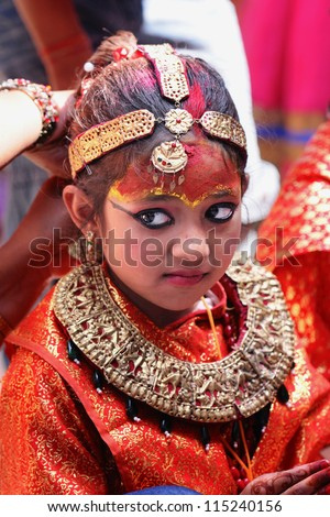 KATHMANDU- SEP 28: unidentified child dressed as Kumari at Indra Jatra celebration on September 28, 2012 in Kathmandu, Nepal. Kumari is a girl believed to be the incarnation of Hindu goddess Durga.