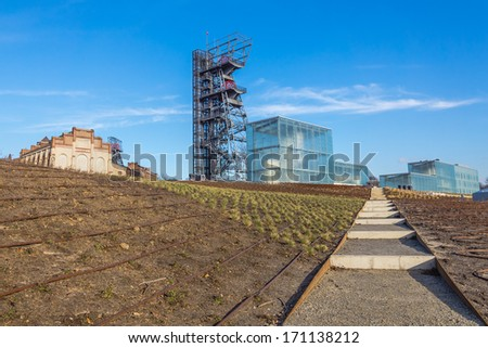 "KATOWICE, POLAND - JANUARY 11, 2014: The former coal mine ""Katowice"", seat of the newly built Silesian Museum. The complex combines old mining buildings and infrastructure with modern architecture."