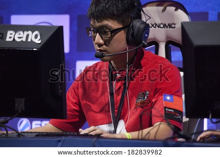 "KATOWICE, POLAND - MARCH 16: Li ""Jay"" Chieh from AZUBU Taipei Assassins at Intel Extreme Masters 2014 (IEM) - Electronic Sports World Cup on March 16, 2014 in Katowice, Silesia, Poland. - stock photo"