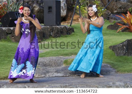 KAUAI, HAWAII - AUGUST 7: Aloha festival. Attractive young girls in traditional dress perform Hawaiian dance on August 7, 2012 in Lihue, Kauai. - stock photo