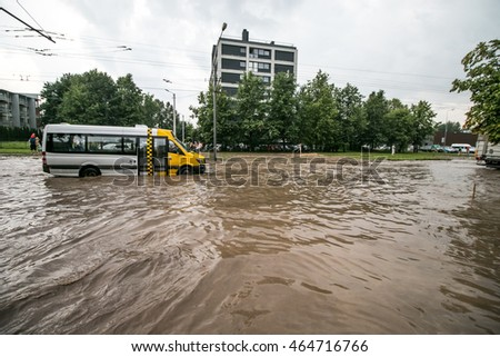 KAUNAS, LITHUANIA - JULY 27, 2016: The big flood after storm. The water floods the streets and the cars. Cars sink in the water. The water flows into the streets