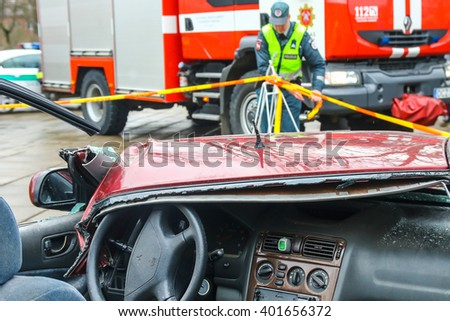 KAUNAS, LITHUANIA - MARCH 6, 2016: Car crash. Car accident. Police man working in the background - stock photo