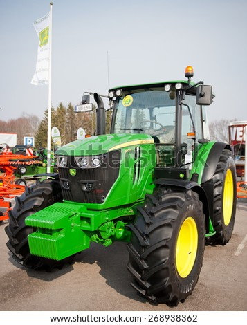 KAUNAS-MAR 26: John Deere 6110 RC Agricultural Tractor on display on Mar. 26, 2015 in Kaunas, Lithuania. John Deere-Deere & Company is the leading manufacturer of agricultural machinery in the world. - stock photo