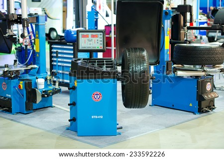 KAUNAS - SEP 19: Taida STD-412 Wheel Balancer on Sep. 19, 2014 in Kaunas, Lithuania. TaiDa is an EJV Sino-Italian carried out between the Chinese firm Hong Da Group and the Italian company TAG S.R.L. - stock photo