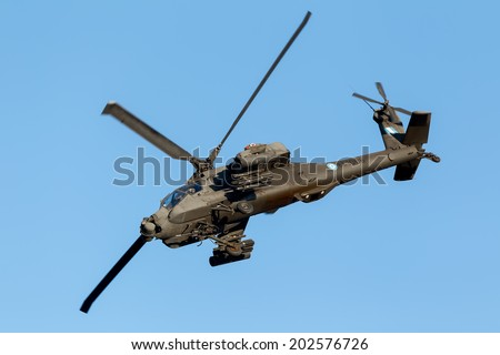 KAVALA, GREECE- JUNE 21, 2014: Apache AH-64 flying during the Kavala Airshow 2014, in Kavala, Greece. - stock photo
