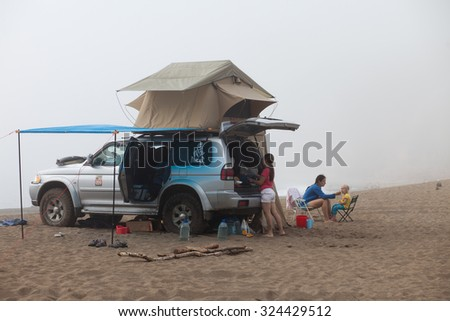 KAVALEROVO, RUSSIA - AUGUST 20, 2014: Mitsubishi Pajero Sport with rooftop tent on sandy beach. Camping life - stock photo