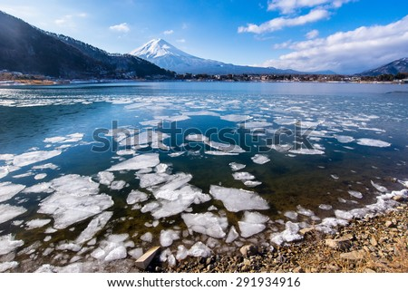 Kawaguchiko lake is ice in winter Mt. Fuji background, Yamanashi, Japan - stock photo