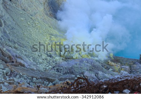 Kawah Ijen volcanic crater lake and toxic sulfur fume, East Java, Indonesia - stock photo