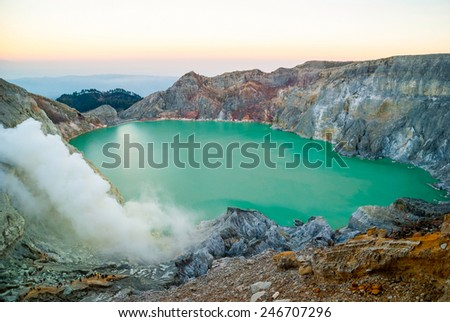 Kawah Ijen volcanic crater with lake at morning dawn, Java, Indonesia - stock photo