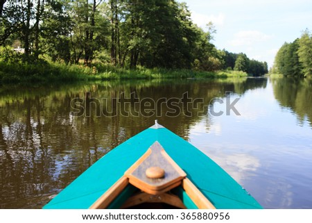 kayak on a small river  - stock photo