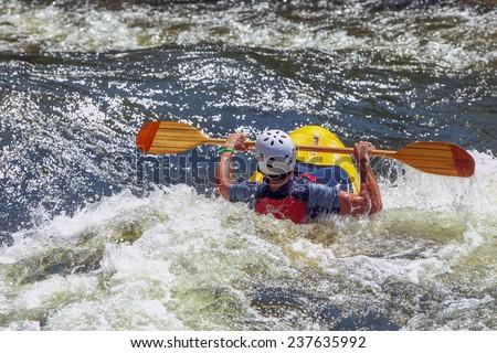 Kayak on rough water - stock photo