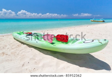 Kayak on the beach of Caribbean Sea of Mexico - stock photo