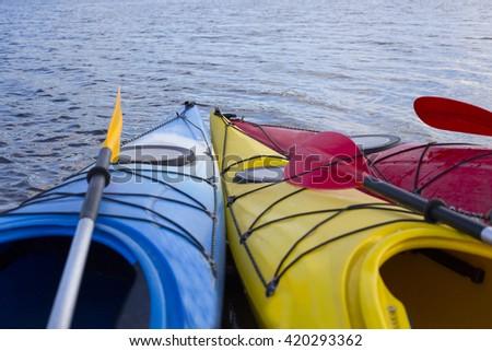 Kayak on the beach on a sunny day. - stock photo
